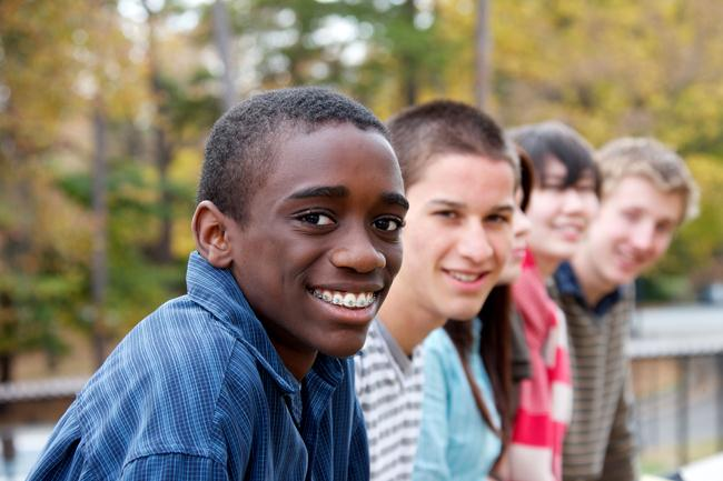 smiling teenage students